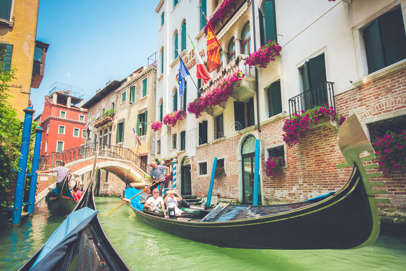 Gondolas on canal in Venice, Italy with retro vintage filter effect royalty free stock images