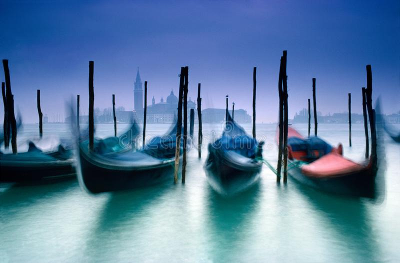Venice Gondolas on Grand Canal with church of San Giorgio Maggiore in the background during Venice Carnival Italy. Venice Gondolas on Grand Canal with church of royalty free stock image