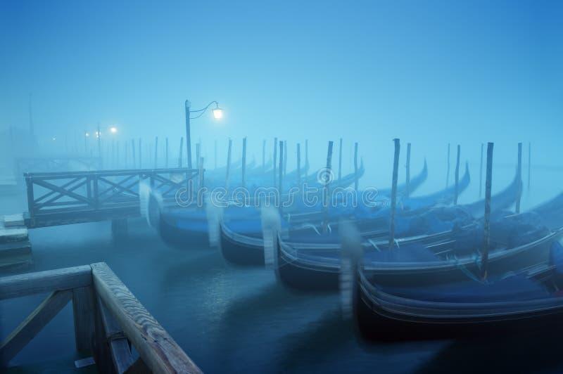 Gondolas in the fog royalty free stock image