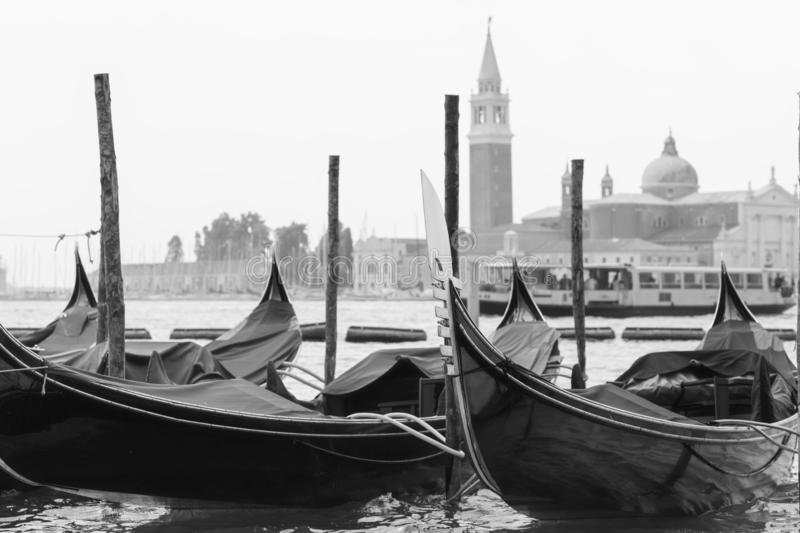 Gondolas moored in Venice stock images