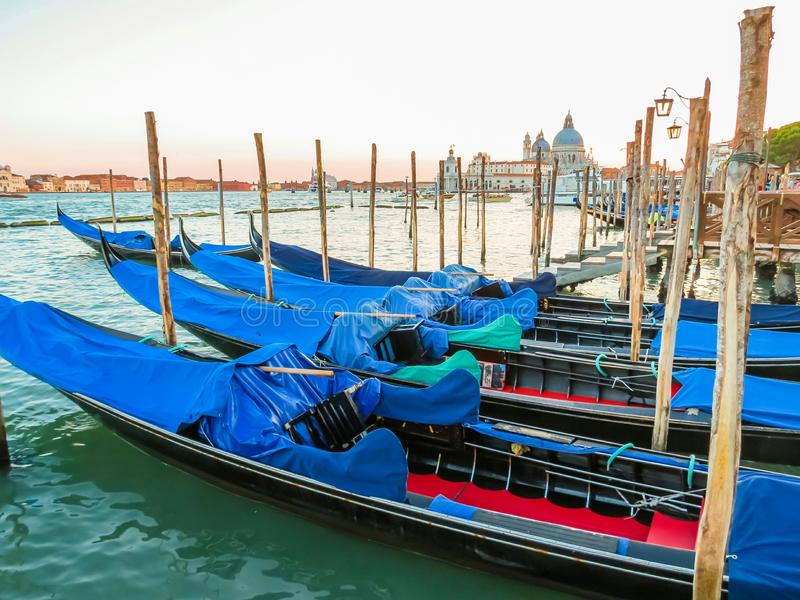 Gondolas moored in the Venetian lagoon stock images