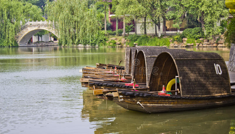 Gondolas in Nanjing China. Some gondolas lined up along the river in a park in Nanjing China royalty free stock photography