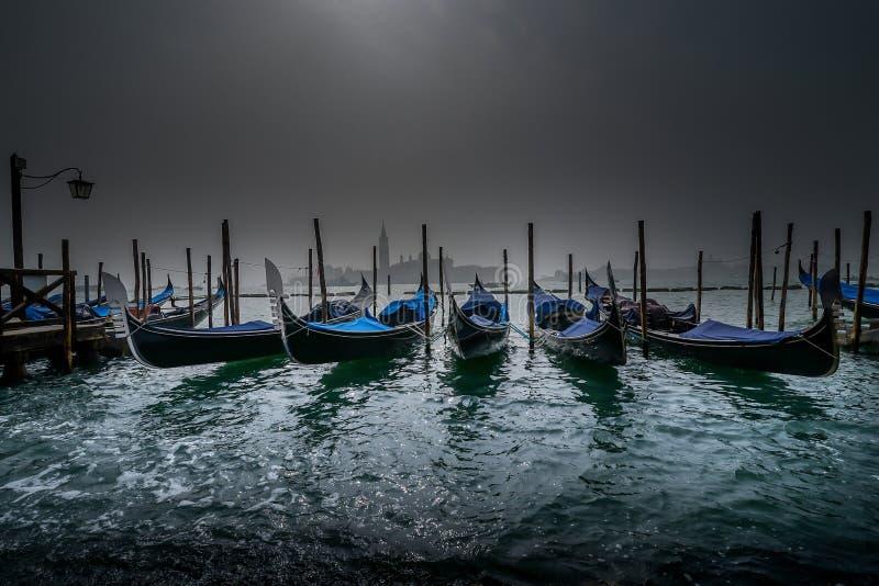 Gondolas at night. By fog stock photography