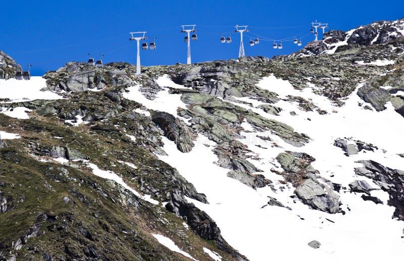 Gondolas over mountain ridge, Molltaler Glacier royalty free stock photography