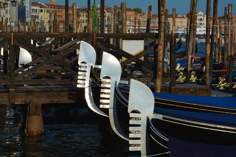 Gondolas parked in St. Mark's Square, Venice. Gondolas parked near a wooden bridge in St. Mark's Square, Venice, Italy, Europe royalty free stock photo