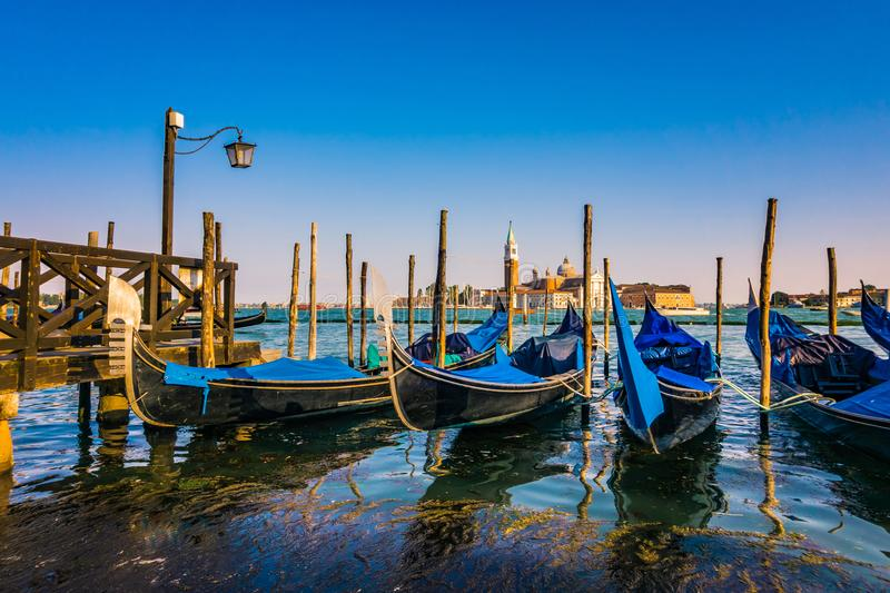 Gondolas with San Giorgio di Maggiore church in the background. Venice, Venezia, Italy, Europe. stock photos