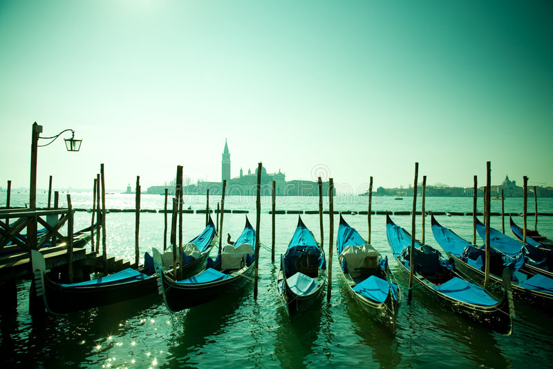 Gondolas, Venice, Italy. A bunch of gondolas floating on the canal in Venice, in front of the island of San Giorgio Maggiore, Italy stock photography