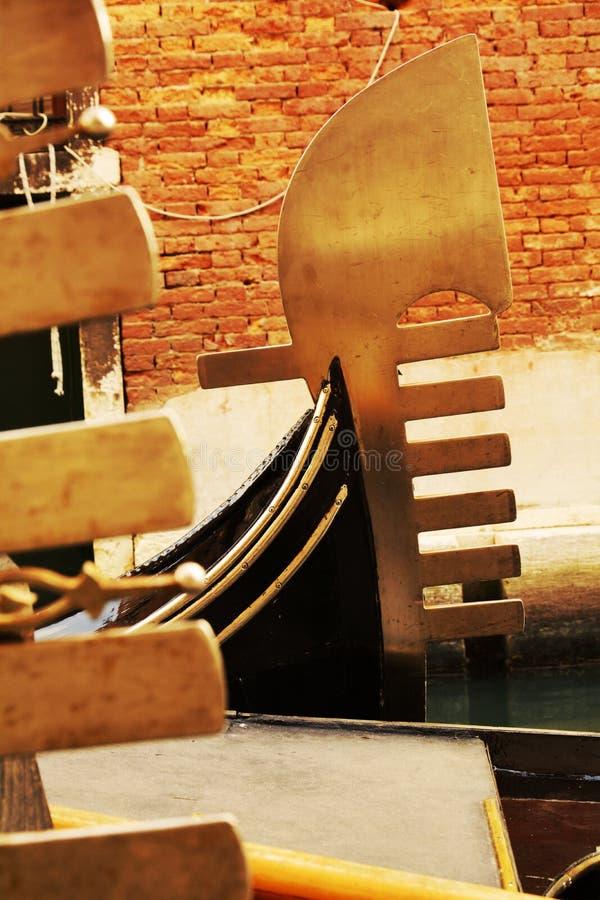 Gondolas in yellow hues, Venice, Italy. Golden decorations details of gondolas and famous bridges in Venice in yellow hues, Italy, Europe stock images