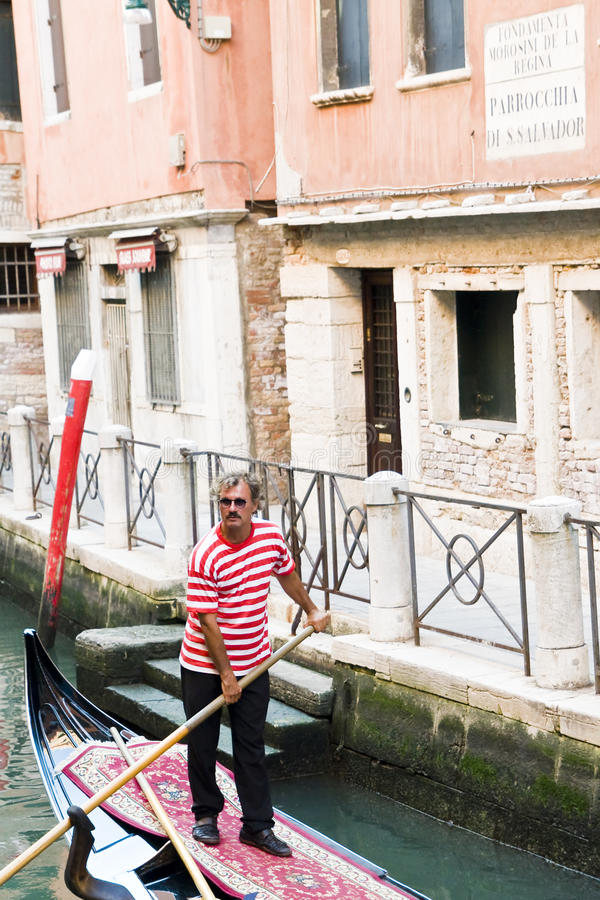 Download Gondolier editorial photography. Image of tourism, venetian - 18531302