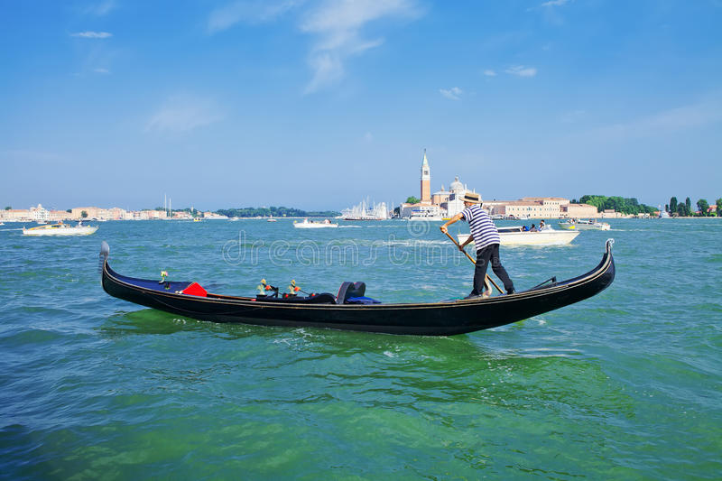 Gondolier on a gondola royalty free stock images