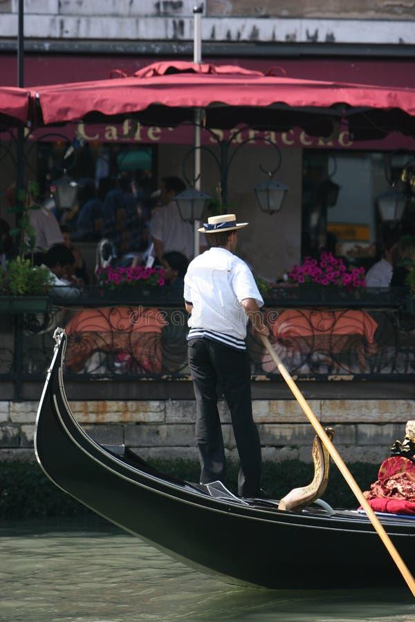 gondolier italy venice royaltyfri bild
