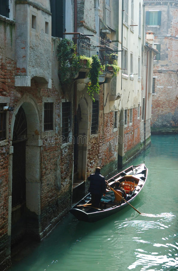 Gondolier taking tourists on Venice canals