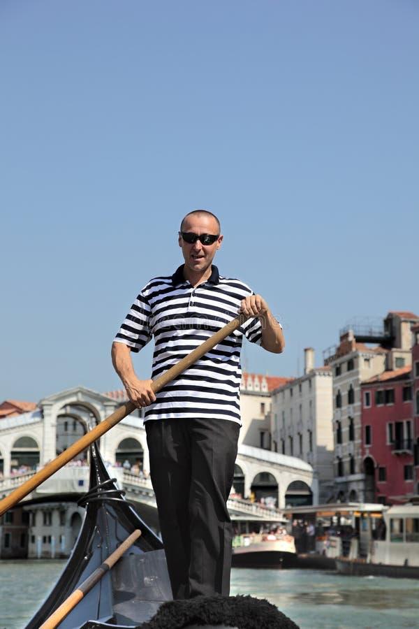 Gondolier a Venezia immagini stock