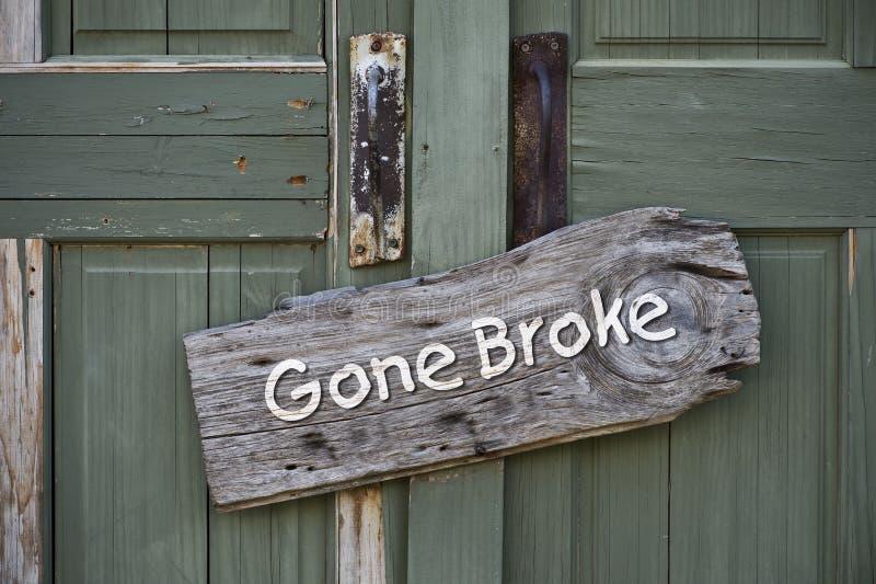 Gone Broke. Gone broke sign on old green doors stock photography