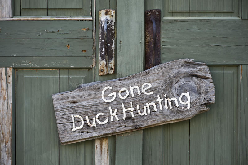 Gone Duck Hunting. Gone duck hunting sign on doorway stock photo