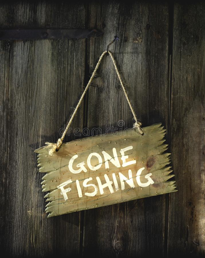 A sign with Gone fishing royalty free stock photo