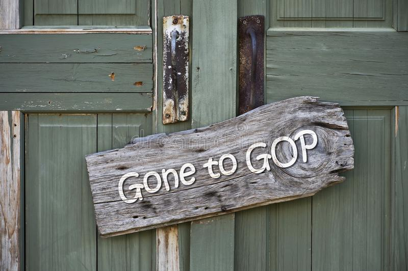 Gone to GOP. Gone to GOP sign on old green doors royalty free stock photography