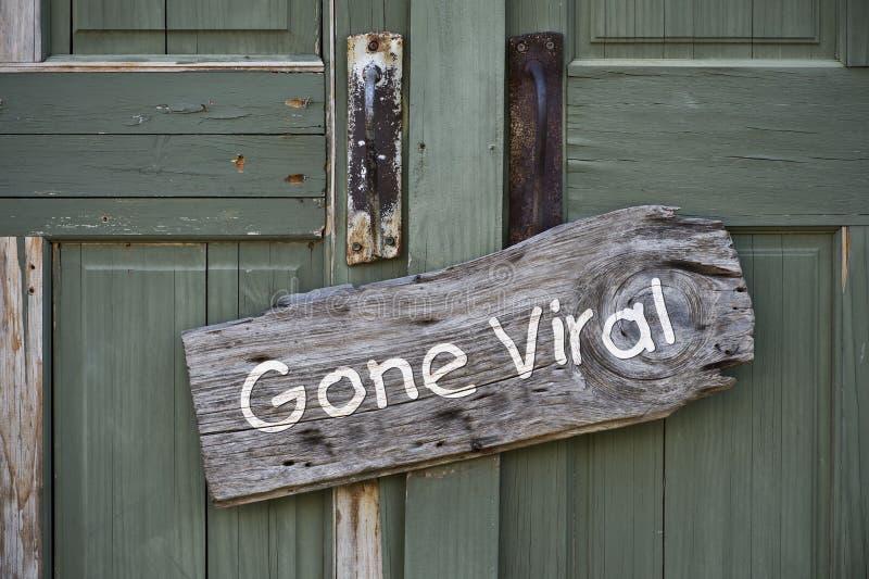 Gone Viral Sign. Gone viral sign on old doorway