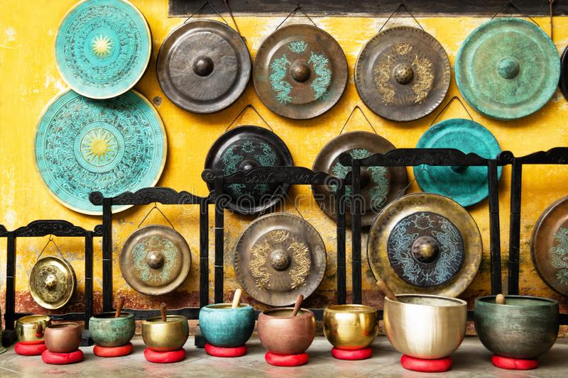 Gongs and singing bowls - traditional Asian musical instruments on a street market. royalty free stock photography