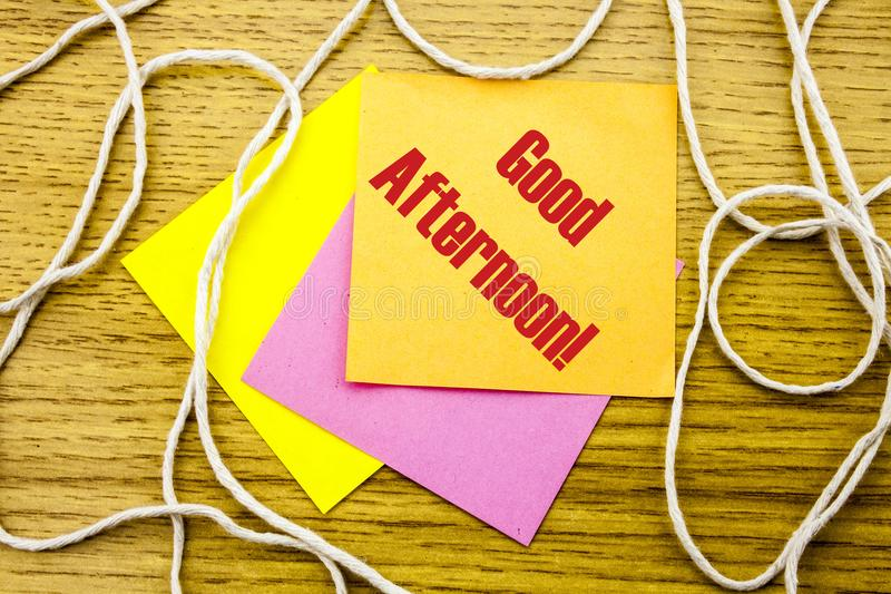Good Afternoon word on yellow sticky note in wooden background. Bussines concept. Good Afternoon. word on yellow sticky note in wooden background. Bussines stock photography