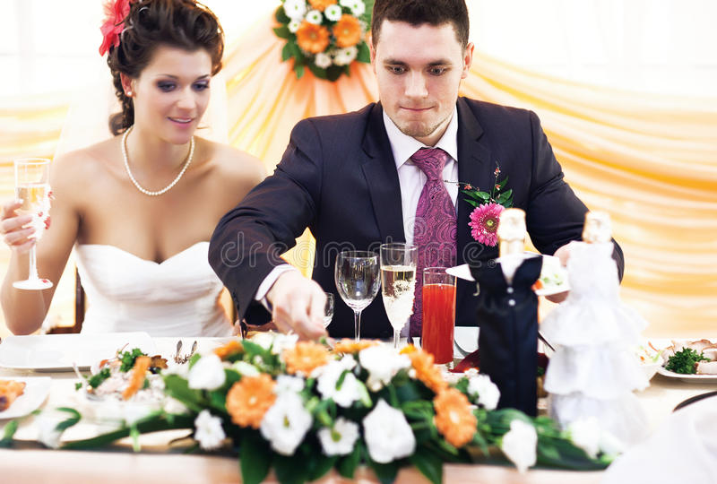 Good appetite. Husband taking food on wedding royalty free stock image
