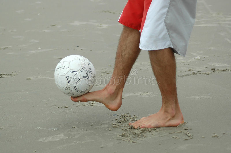 Good Balance. Beach soccer ball balanced above the foot royalty free stock photography