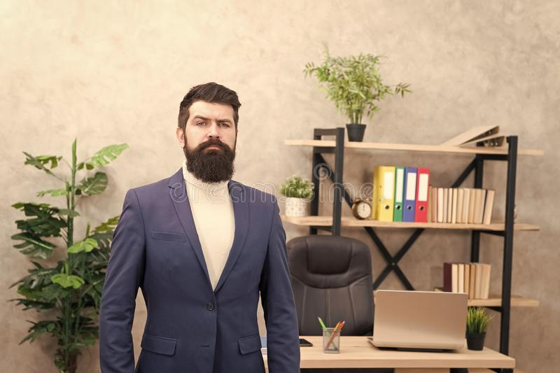 Good boss is good leader. Man bearded hipster boss looking at you with attention. Boss standing in office. Boss receive royalty free stock image