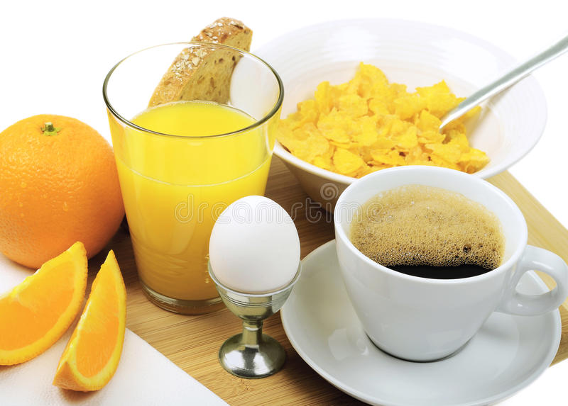 A good breakfast. With coffee, juice, eggs, bread, cornflakes and orange stock images