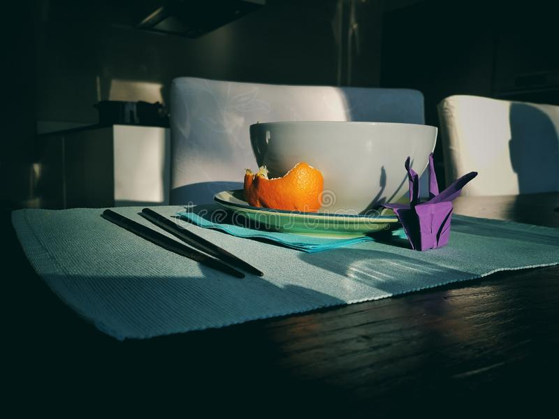 A good breakfast. A nice breakfast with a orange and a origami stock image