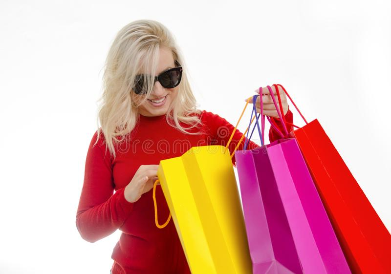 Good buy, happy woman looking cheerfully in her shopping bags royalty free stock images