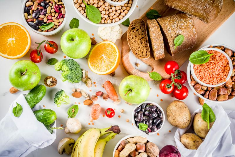 Good carbohydrate fiber rich food. Healthy food. Selection of good carbohydrate sources, high fiber rich food. Low glycemic index diet. Fresh vegetables, fruits royalty free stock photo