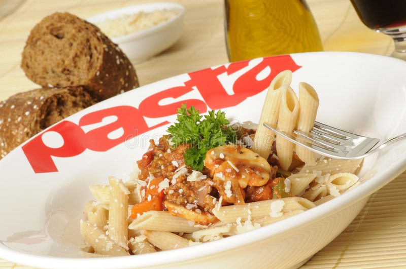 Good carbohydrates. A plate with whole-wheat pasta and bolognese sauce royalty free stock photos