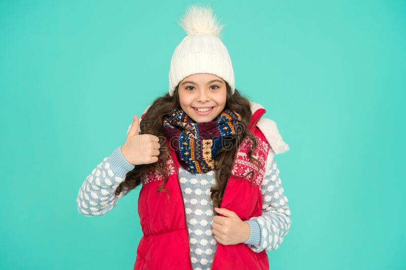 Good choice. Stay warm and stylish. Cold winter days. Vacation time. Stay active during season. Kid wear knitted warm. Clothes. Winter vibes. Youth street royalty free stock photos