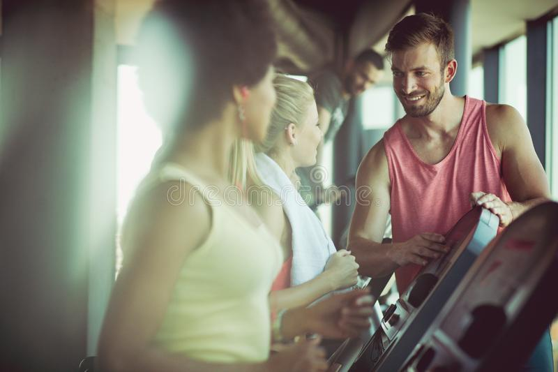 Good day for gym. People at gym stock photo