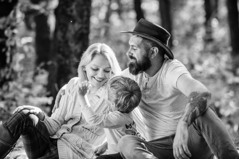 Good day for spring picnic in nature. Explore nature together. Family day concept. Mom dad and kid boy relaxing while. Hiking in forest. Family picnic. Mother stock image