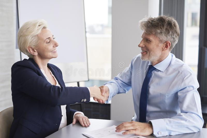 Good deal between businessman and customer. In the modern office stock photo