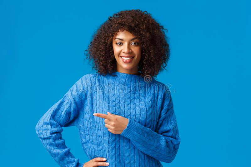 Good deal right over corner. Confident pleasant friendly-looking african american gorgeous woman with afro haircut royalty free stock image