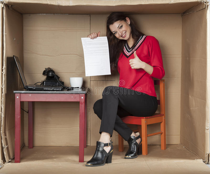 Good deal of work, thumbs up. Business woman stock image
