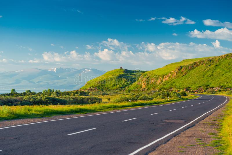 Good empty mountain road with a picturesque view of the mountains, the landscape. Of Armenia stock images