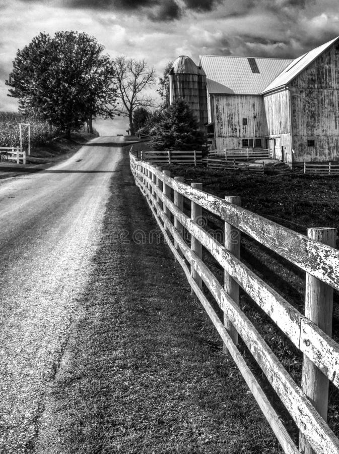 GOOD FENCES MAKE GOOD NEIGHBORS - AMISH COUNTRY - OHIO - WHITE FENCE. The Amish are a group of traditionalist Christian church fellowships with Swiss German royalty free stock images