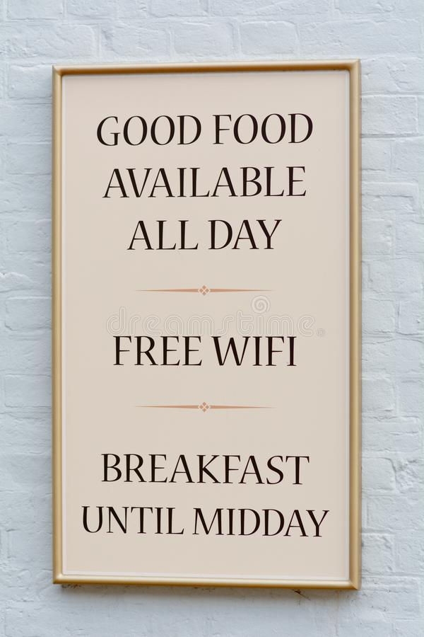 Good Food Available All Day and Free Wifi sign outside pub. Lic house royalty free stock photo