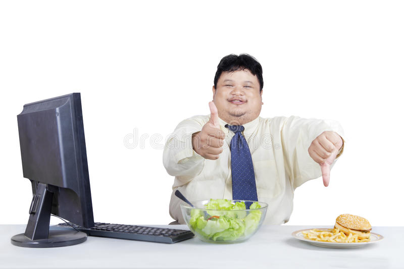 Good food and bad food. Fat businessman showing hand gesture for showing good food and bad food stock photos