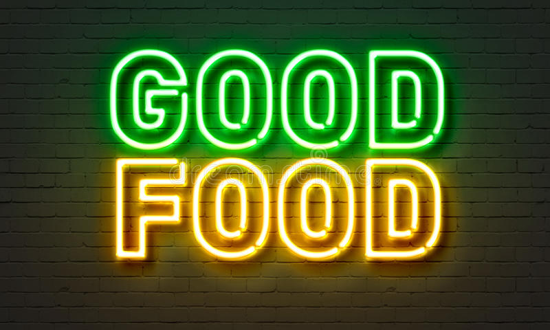 Good food neon sign on brick wall background. Good food neon sign on brick wall background stock photography