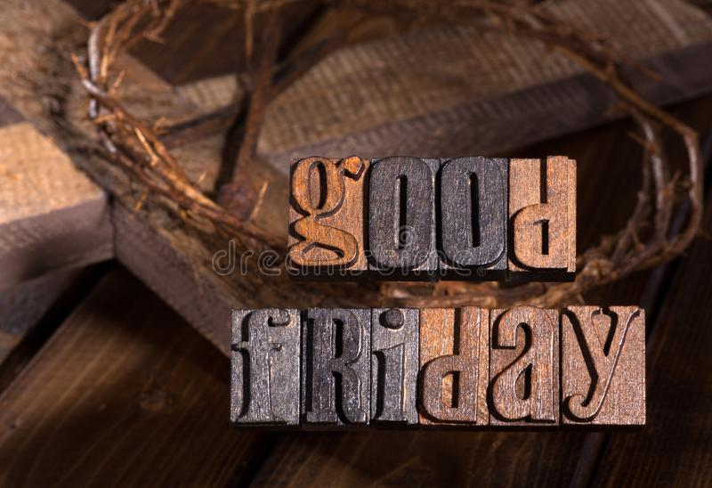 Good Friday Wooden Text. Good Friday text with crown of thorns and cross in background royalty free stock photo