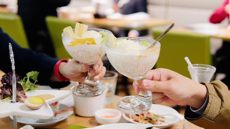 Good friends cheer with ice cream, enjoy their happy time royalty free stock photos