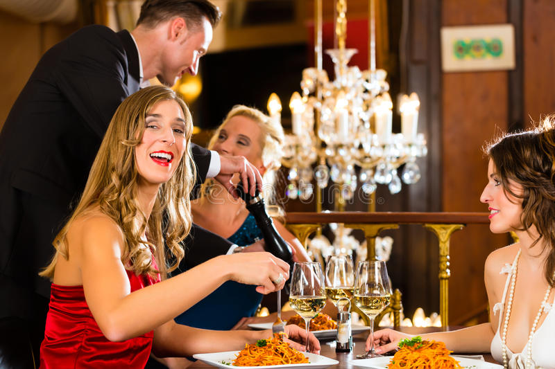 Waiter spices the dinner in a fine restaurant royalty free stock image