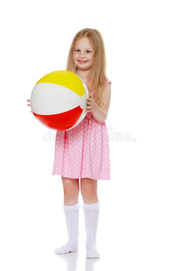 Little girl is playing with a ball stock photo