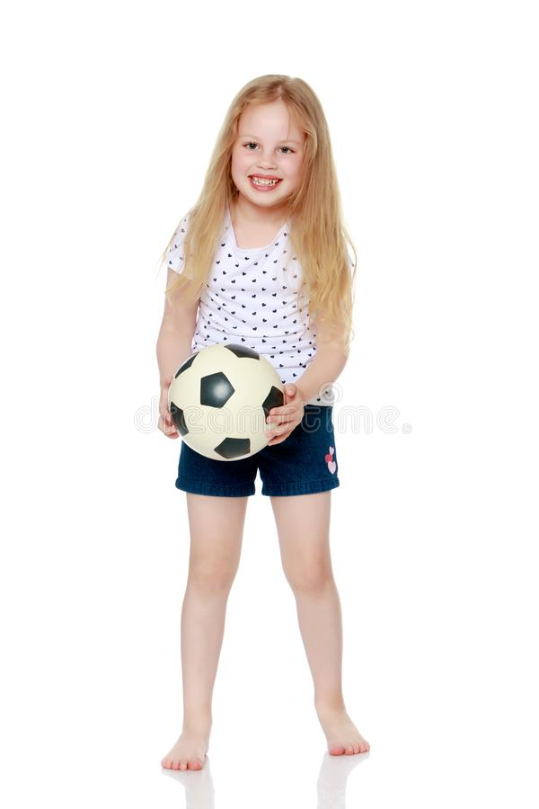 Little girl is playing with a ball royalty free stock photography