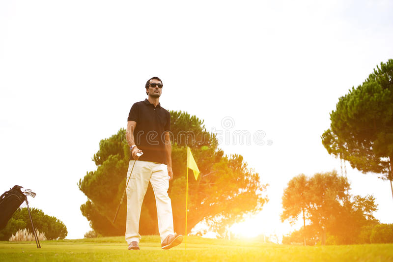 Good golf game at sunny summer day on the course. Full length portrait of professional golf player walking to the next hole on beautiful course, good golf game royalty free stock photos