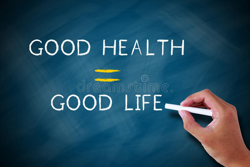 Good health good life. Written in chalk on a chalkboard royalty free stock photography